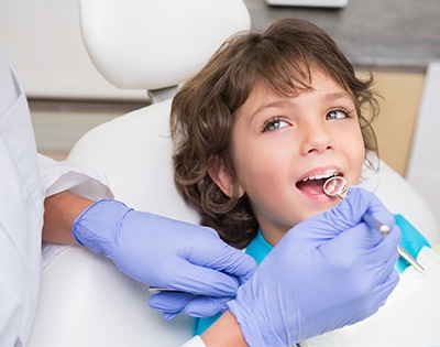 Child receiving dental treatment