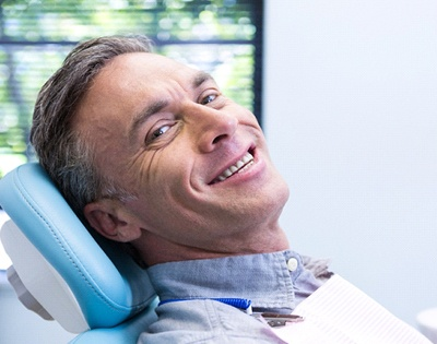 Man in dentist's chair smiling