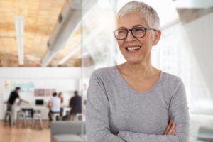 older lady smiling with dental implants