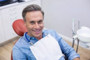 Dental patient smiling after receiving anesthesia-free fillings in Pasadena